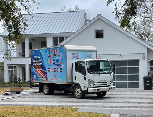 Central Heating And Air Truck In Front Of House